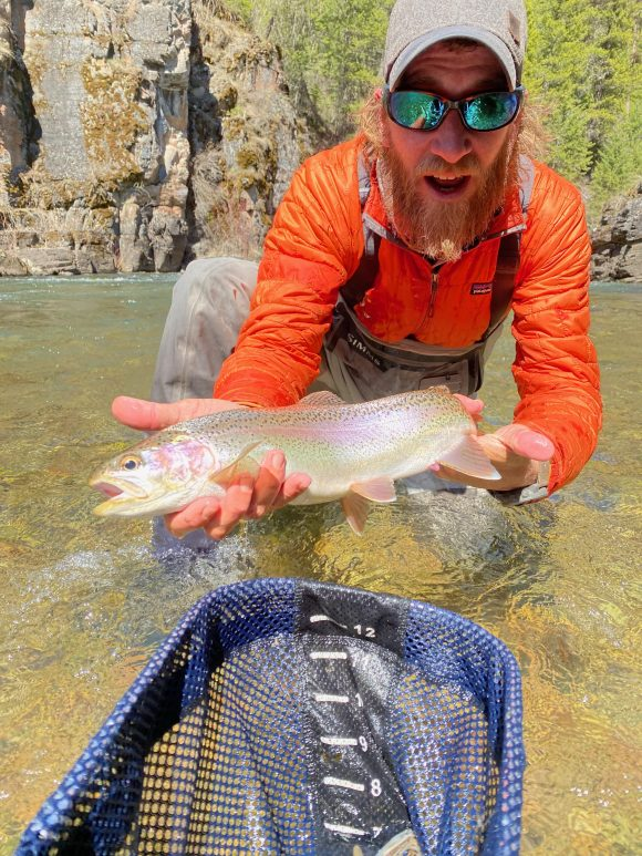 Astonished man with a rainbow trout.